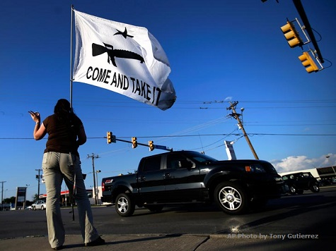Women Protest Open Carry of Guns by Baring Breasts at Texas Rally