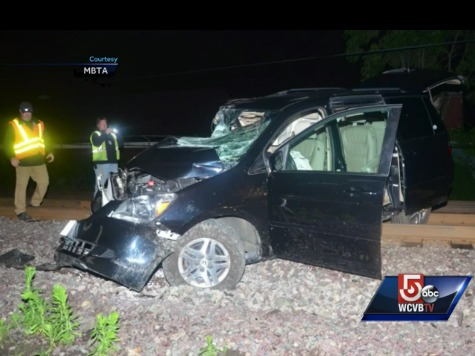 GPS Leads Woman onto Railroad Tracks, Minivan Destroyed