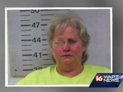 Cops: Woman Shoots Husband in Drive-By