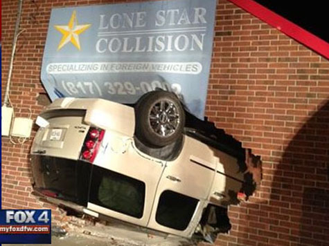 PHOTO: SUV Crashes Upside Down Into Collision Repair Shop
