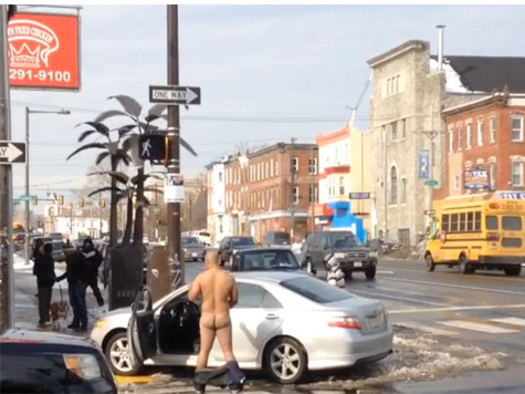 Video: Man Crashes Car Into Fried Chicken Restaurant, Strips Naked, Masturbates in Intersection