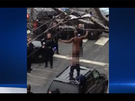 VIDEO: Naked Man Atop SUV Taunts Police